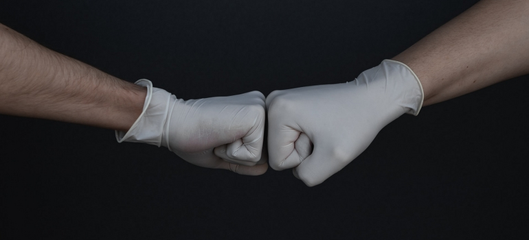 Two hands with gloves