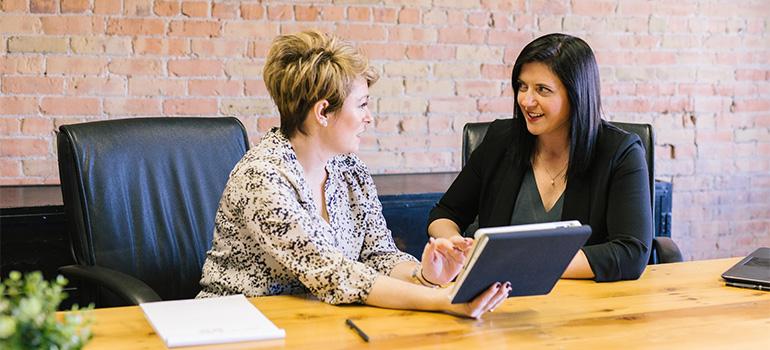 Two women in an office, speaking