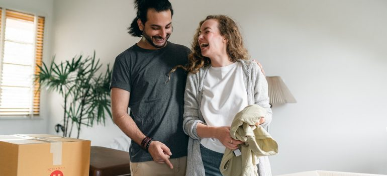 Couple smiling after getting packing services Florida