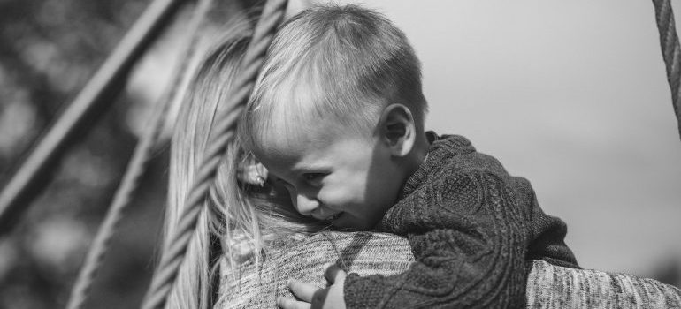 A woman holding a boy.