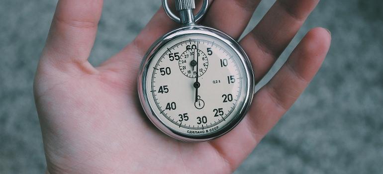 A hand holding a pocket watch