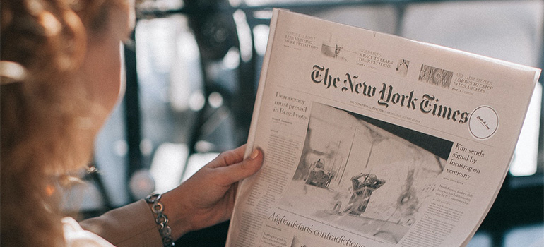 A woman reading The New York Times