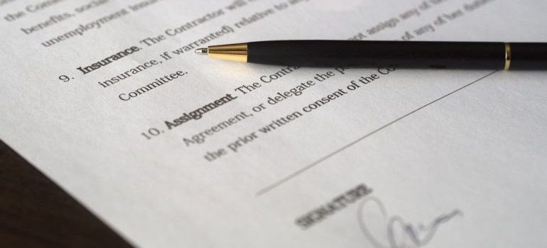 signed document and a pen on table