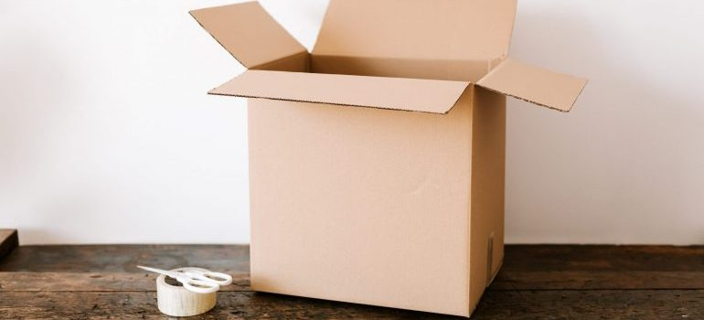 a cardboard box to remind you of packing tips for a long-distance move