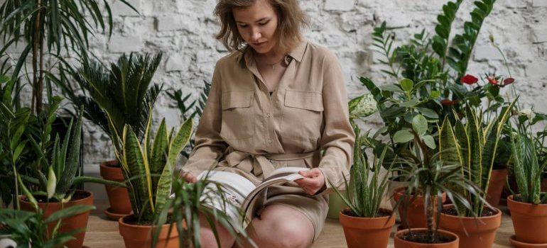 woman reading among plants