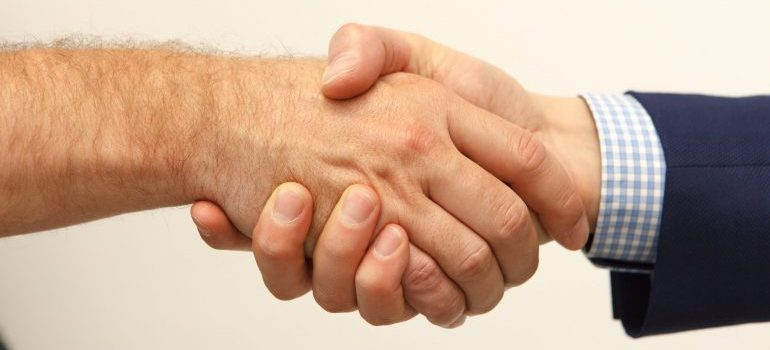 people shaking hands for choosing the best moving company in Boca Raton