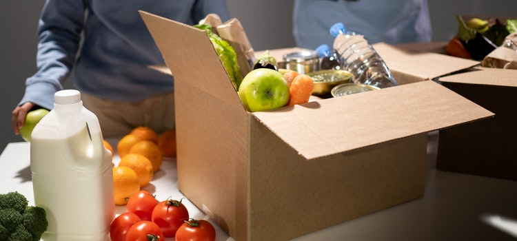 A box filled with food on a kitchen table